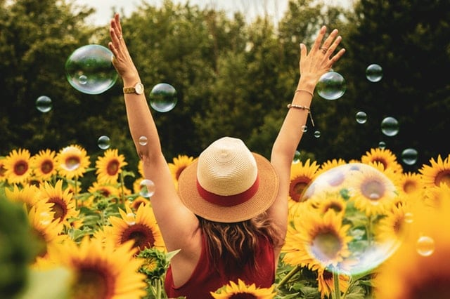 happy woman in sunflowers